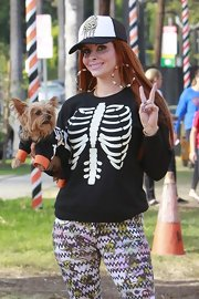 Phoebe got in the spooky Halloween spirit with this skeleton-print sweater.