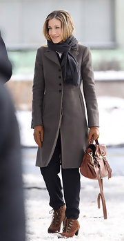 Sarah Jessica Parker filmed scenes for an upcoming movie in brown suede lace up boots.