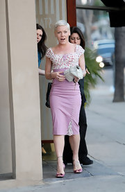 Looking pretty in pink, Pink showed off her beige leather clutch while out with a friend in Sherman Oaks.