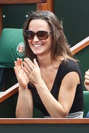 Pippa Middleton sat court side at the French Open wearing horsebit and bamboo temple sunglasses.