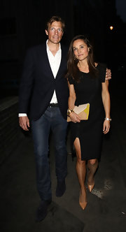 Pippa wore a more modern black dress with square shoulders and a high thigh slit in the front while out with her boyfriend Nico Jackson.