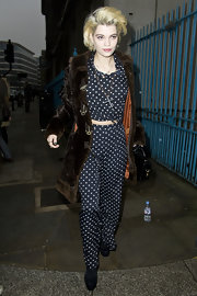 Pixie donned a polka-dot two-piece ensemble at London Fashion Week under a long toggle fur coat.