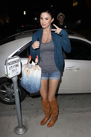 Jayde Nicole carried a faded denim Louis Vuitton monogram tote out to dinner.