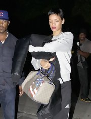 Rihanna styled her super sporty look with a printed Gucci bowler bag.
