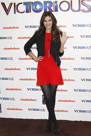 Victoria Justice gave her fiery red dress an edge with a zipper-detailed blazer.