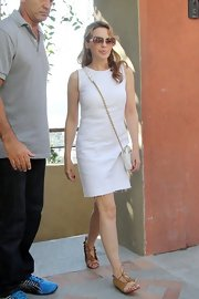 Kylie Minogue kept her look light, finishing off her white shift with a little white chain strap bag.