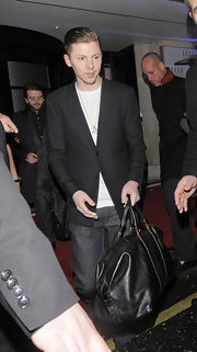Professor Green was spotted at the Savoy Hotel carrying a stylish black leather duffel bag.
