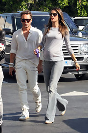 Alessandra showed off her baby bump in this gray-on-gray ensemble.