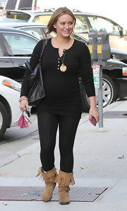 Hilary Duff kept her street style relaxed in black leggings and a matching henley.