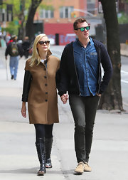 Jaime King chose a tan wool coat with leather sleeves for her cool and contemporary look while out with her husband in NYC.