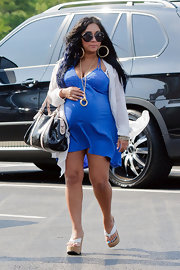 Pregnancy doesn't stop Snooki's short hemlines! The petite gal bustled around wearing this blue knit day dress.