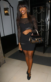 Alexandra Burke added a luxe touch to her evening wear with a Louis Vuitton tote.