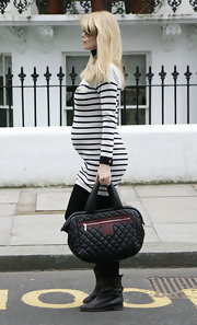 "Showing off her cure baby bump, Claudia Schiffer made her way home after picking up her kids from school. She carried a super chic ""Cocoon"" bag."