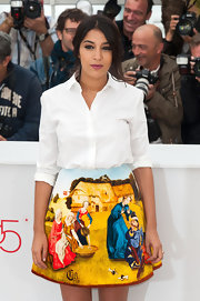 Leila Bekhti kept it classic with a crisp white button-down at a premiere in Cannes.