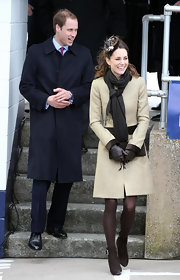 Prince William bundled up in a navy trench coat for his official appearance with Kate.