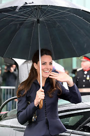 Kate Middleton kept dry with this classic black umbrella.