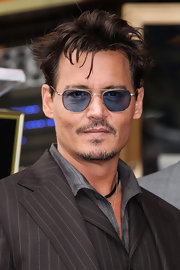 Johnny Depp wore classic aviators with a twist when he sported these blue shades.