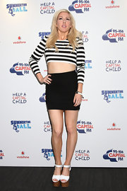 Ellie Goulding completed her eye-catching get-up with a pair of super-high platform sandals.