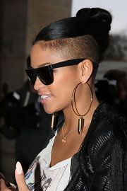 Cassie attended fashion week in Paris wearing her tresses in tight top knot.