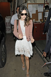 Rachel Bilson donned a sweet outfit for her visit to the 'Regis and Kelly' show in NYC. The style maven wore a pretty lacy white frock that she accessorized with black leather bag with gold hardware.