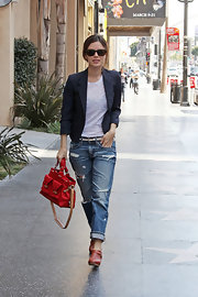Staying stylish is one thing Rachel always accomplishes when leaving the house. She paired her red clogs with a hip leather red tote, boyfriend jeans and a navy blazer.