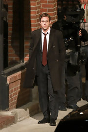 Ryan Gosling embodied the serious character he played on 'Ides of March' by wearing a classic solid tie.
