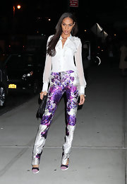 Joan Smalls rocked Prabal Gurung trousers paired with purple accent pumps.