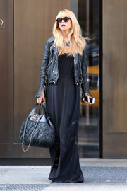 Rachel Zoe was boho as usual, but with an edgy twist, in this dark blue maxi dress and leather jacket combo.