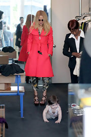 Rachel Zoe paired this pink coat with her silk print jumpsuit while out shopping with Skyler.