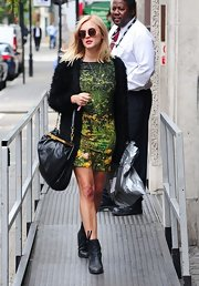 Fearne Cotton looked stylish and artistic in this green photographic print dress on her way to work.