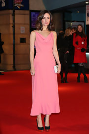 Rose Byrne looked sweet and rosy in this pink tea-length dress with a cowl neck at the London premiere of 'I Give It a Year.'
