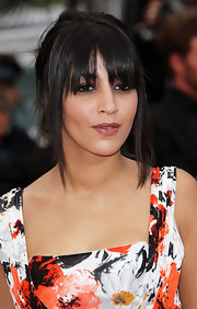 Leila Bekhti wowed the crowd in a sexy updo with long bangs at a screening in Cannes.