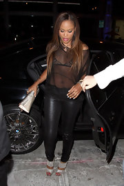 Eve complemented her all-black outfit with a pair of glittery evening sandals during a night out at Trousdale Lounge.