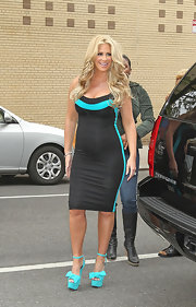 Kim Zolciak made an appearance on the 'Wendy Williams Show' wearing a bright turquoise pair of platforms featuring ankle straps and bows.