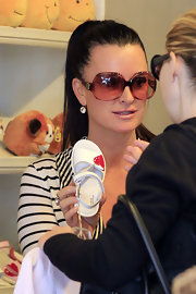 Kyle Richards upped the glam factor of her look with a pair of oversize rose-tinted shades.