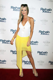Joanna Krupa hosted the Rehab Bikini Invitational where she wore this crocheted white mini dress with an asymmetrical sarong.