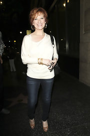 Caroline Manzo paired blue skinnies with a white scoopneck sweater for a totally hip look.