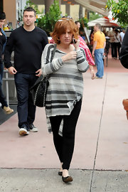 Caroline Manzo kept it easy-breezy with a striped loose blouse and leggings while shopping in Miami.