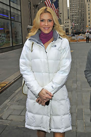 Brandi Glanville beat the winter chill with a long white puffer jacket while leaving the 'Today' show.