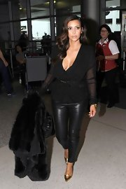 Kim Kardashian finished off her sleek leather pants look with striking T-bar gold pumps.