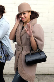 Rebecca Ferguson looked totally stylish in this nude cloche and coat combo as she arrived at the Fountain Studios.