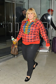Rebel Wilson chose this plaid zip-up jacket for her funky daytime look while out in NYC.