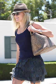 Reese Witherspoon paired her cute daytime outfit with a timeless gold watch.