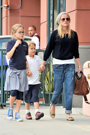 Reese is one stylish mommy. She pairs her boyfriend jeans with these sweet, bow-embellished, suede flats.