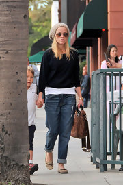 Reese showed off her winter knit-wear while out with son Deacon. Her slouchy beanie works well with her relaxed yet stylish outfit.