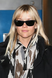 Reese Witherspoon rocked a pair of classic Wayfarers and a new set of bangs in Paris.