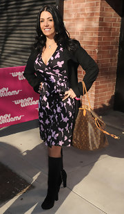To keep her floral wrap dress winter-appropriate, Renee Graziano layered it with a black blazer.