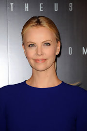 Charlize Theron completed her look for the Paris premiere of 'Prometheus' with a pair of white gold and diamond stud earrings.