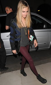 Cara topped off her look with burgundy skinny pants.