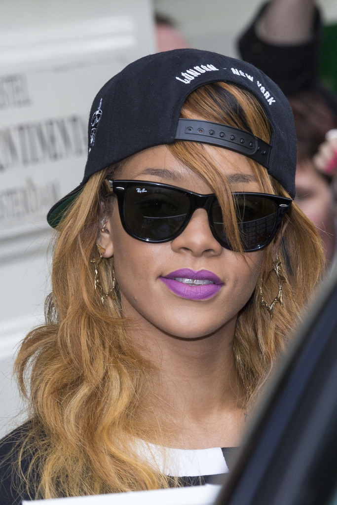911b741f3c85 Rihanna looked hip and stylish in classic black Ray Ban wayfarers. Wayfarer  Sunglasses
